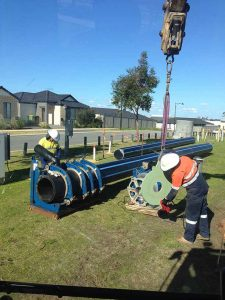 Groundforce Civil employees butt welding poly pipe.