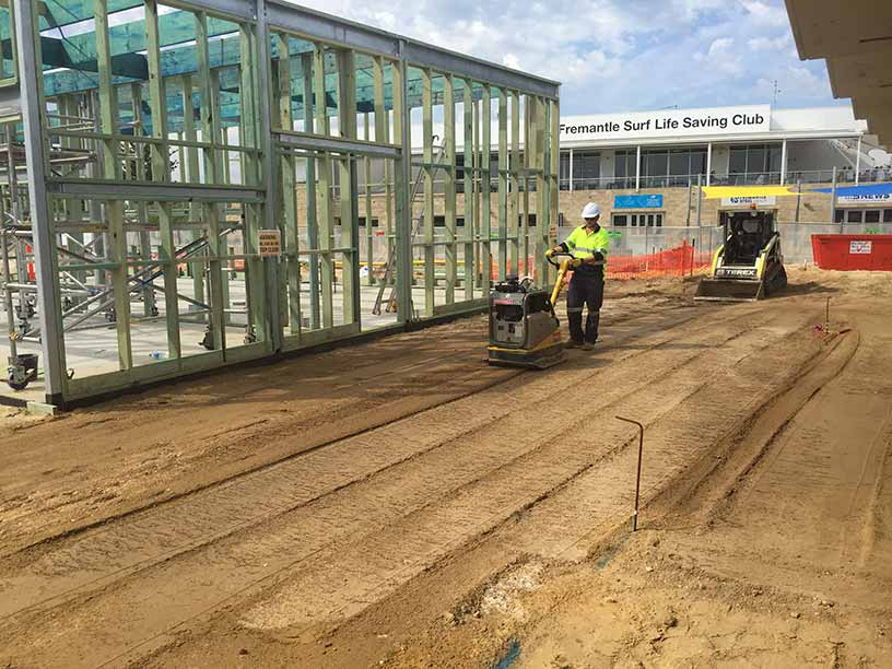 Groundforce Civil employee site compacting after site leveling with skid steer.