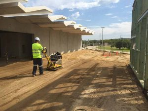 Groundforce Civil employee operating a compactor